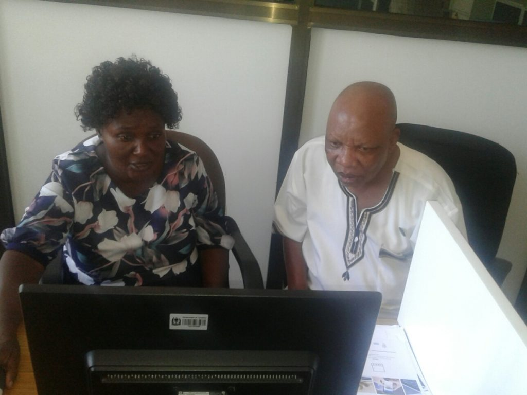 PICTURE WITH DAINES MTEI LOOKING AT CAADP RECORDS